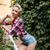 boldog · gyönyörű · tő · felfelé · lány · áll - stock fotó © deandrobot