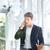 深刻 · ビジネスマン · 立って · 話し · 携帯電話 · オフィス - ストックフォト © deandrobot