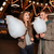 couple with cotton candy standing and laughing in amusement park stock photo © deandrobot