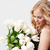 side view of smiling blonde woman posing with bouquet flowers stock photo © deandrobot