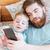 boldog · férfi · okostelefon · ágy · jóképű · fiatalember - stock fotó © deandrobot