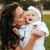 mother kissing her little daughter in park stock photo © deandrobot