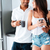 couple standing and drinking coffee together at the kitchen stock photo © deandrobot