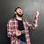 cheerful bearded young man laughing and using smartphone stock photo © deandrobot