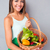 smiling woman holding basket with vegetables stock photo © deandrobot