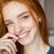 smiling redhead woman looking at camera stock photo © deandrobot