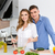 beautiful couple standing and cooking together stock photo © deandrobot