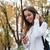 glimlachende · vrouw · permanente · luisteren · naar · muziek · mobiele · telefoon · glimlachend · asian - stockfoto © deandrobot