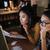 ernstig · onderneemsters · collega · werken · laptop · kantoor - stockfoto © deandrobot