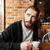 портрет · молодым · человеком · питьевой · кофе · расслабиться - Сток-фото © deandrobot
