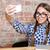uśmiechnięta · kobieta · Fotografia · smartphone · uśmiechnięty · młoda · kobieta - zdjęcia stock © deandrobot