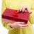 female hands holding gift box stock photo © deandrobot