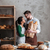 happy loving couple bakers holding bread in hands stock photo © deandrobot