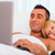 father and son in bed using laptop together stock photo © deandrobot
