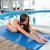 girl doing yoga exercises on mat stock photo © deandrobot