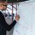 businessman writing on a flipchart stock photo © deandrobot
