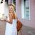 glimlachende · vrouw · beschikbaar · koffiekopje · muur · portret - stockfoto © deandrobot