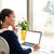 вид · сбоку · африканских · деловой · женщины · используя · ноутбук · служба · платье - Сток-фото © deandrobot