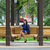 cute · donna · seduta · panchina · parco · lettura - foto d'archivio © dedmorozz