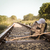railway track crossing rural landscape with travel backpack stock photo © denisgo