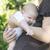 bebek · anneler · silah · kadın · kanepe · gülme - stok fotoğraf © deyangeorgiev