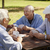 active seniors group of old friends playing cards at park stock photo © diego_cervo