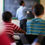 middle aged teacher at blackboard giving class of math stock photo © diego_cervo