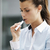young woman smoking electronic cigarette outdoor office building stock photo © diego_cervo