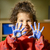 Happy little girl painting with hands in kindergarten stock photo © diego_cervo