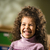 Happy female child smiling for joy in kindergarten stock photo © diego_cervo