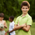 portrait of boy and friends playing football in park stock photo © diego_cervo