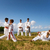 school teachers and children at karate lesson near the sea stock photo © diego_cervo