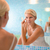 female beauty young woman applying lotion on face at home stock photo © diego_cervo