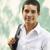 колледжей · молодым · человеком · улыбаясь · портрет · молодые · Hispanic - Сток-фото © diego_cervo