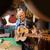 boy learns play guitar with senior man grandpa stock photo © diego_cervo