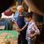 old lute maker teaching grandson boy chiseling wood stock photo © diego_cervo