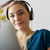 woman with green earphones listens podcast music on tablet stock photo © diego_cervo