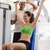 Personal trainer helping woman training in wellness club stock photo © diego_cervo