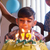 birthday party with happy latino boy blowing candles on cake stock photo © diego_cervo