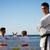 portrait of confident karate trainer watching children fight stock photo © diego_cervo