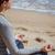 jóga · meditáció · nő · meditál · tengerpart · naplemente - stock fotó © digoarpi