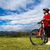 motoros · lány · kilátás · hegy · út · bicikli - stock fotó © digoarpi