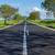straight asphalt road leading into the distance stock photo © digoarpi