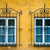 Two windows with ornamental metal lattice stock photo © dinozzaver