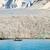 montanas · océano · paisaje · agua · mar - foto stock © dinozzaver
