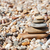 stack of pebble stones on the beach stock photo © dinozzaver