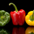 redgreenyellow bell peppers isolated on black stock photo © dla4