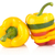 closeup of multicolored slices of bell pepper on white with drops of water stock photo © dla4