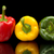 redgreenyellow wet bell peppers on black with water drops stock photo © dla4