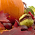 cropped shot of pumpkin with autumn leaves for thanksgiving day on white stock photo © dla4